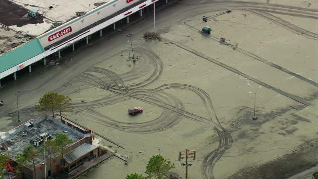 vídeos de stock, filmes e b-roll de september 12 2005 aerial tire tracks in mudcovered parking lot after flood / chalmette louisiana - 2005