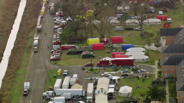 september 12, 2005 aerial vehicles and tents set up at aurora gardens relief camp / new orleans, louisiana - gulf coast states stock-videos und b-roll-filmmaterial