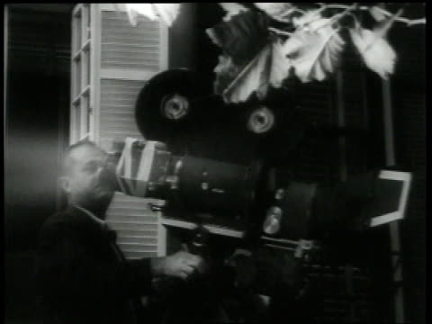 september 13 1954 ms cameraman films marilyn monroe leaning out of a window while waving and smiling / los angeles california united states - 1954 stock-videos und b-roll-filmmaterial