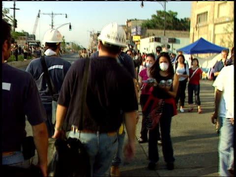 september 13, 2001 construction workers passing applauding volunteers holding american flags and handing out provisions after the world trade center... - september 11 2001 attacks stock videos & royalty-free footage