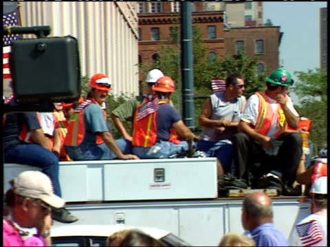 september 13, 2001 construction workers riding on trucks, flying the american flag, into ground zero for clean up and rescue / new york city, new... - 2000s style stock videos & royalty-free footage