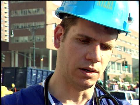 september 13, 2001 volunteer doctor giving interview regarding rescue efforts after the world trade center terrorist attack / new york city, new... - september 11 2001 attacks stock videos & royalty-free footage