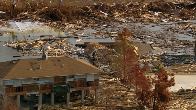 september 13 2005 aerial zoom out destroyed houses and debris along grand lagoon / slidell louisiana - 2005 stock videos & royalty-free footage
