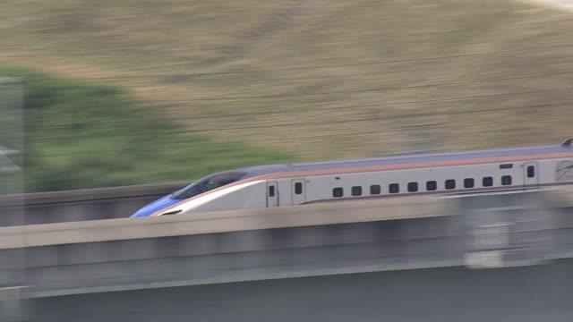 september 14 a hokuriku shinkansen traveling toward the city of namerikawa - satoyama scenery stock videos & royalty-free footage