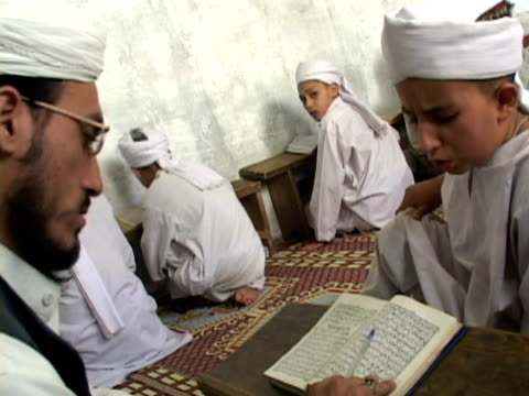 september 15 2005 ms boy reading alcoran in madrassa teacher listening / chitral pakistan / audio - madressa stock videos and b-roll footage