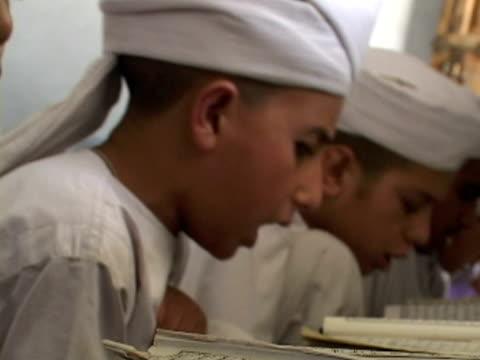 september 15 2005 cu zi boys studying alcoran in madrassa / chitral pakistan / audio - madressa stock videos and b-roll footage