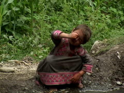September 15 2005 MS Child washing eyes in water / Chitral Pakistan / AUDIO