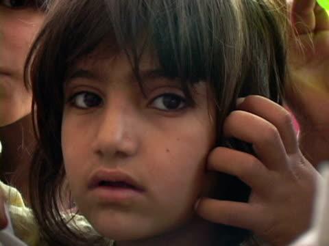 september 15, 2005 children looking at camera / peshawar, pakistan / audio - peshawar stock videos & royalty-free footage