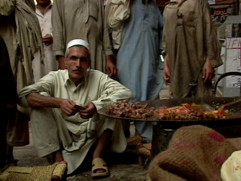 september 15, 2005 customer buying food at stand / peshawar, pakistan / audio - peshawar stock videos & royalty-free footage