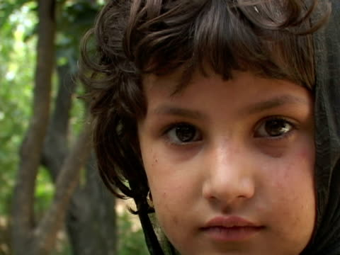 September 15 2005 CU ZI Portrait of girl looking at camera / Peshawar Pakistan / AUDIO