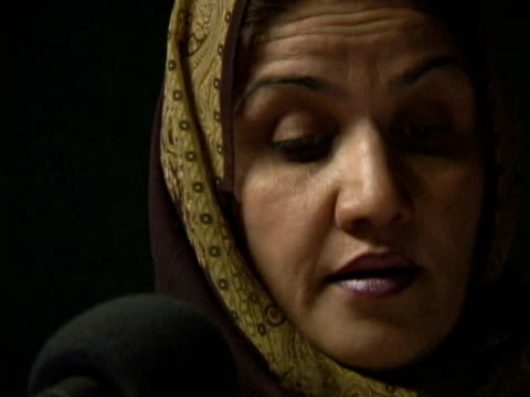 september 15, 2005 woman in hijab speaking to microphone in studio / kabul, afghanistan / audio - one mid adult woman only stock videos & royalty-free footage