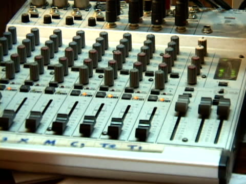 September 15 2005 CU ZO MS Woman in hijab using mixer in recording studio / Kabul Afghanistan / AUDIO