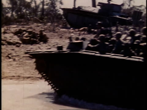 September 16 1944 TS Marines landing on beach of Peleliu in amphibious tracked vehicle / Palau