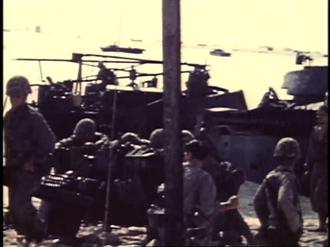 september 16 1944 montage marines on shore and moving equipment off landing craft / peleliu palau - landing craft stock videos & royalty-free footage