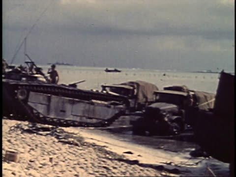 september 16 1944 montage peleliu dday amphibious vehicles trucks and marines on beach / palau - amfibiefordon bildbanksvideor och videomaterial från bakom kulisserna