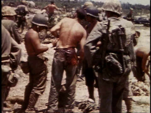stockvideo's en b-roll-footage met september 16 1944 montage peleliu dday with marines on beach bandaging wounded casualty / palau - d day