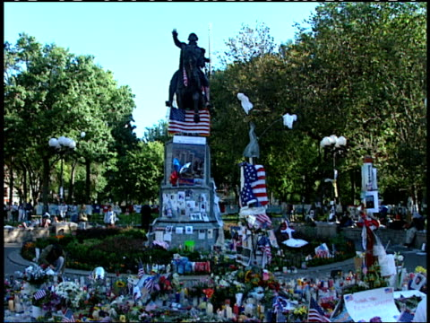 september 16, 2001 flowers, american flags, candles, and trinkets lying in memorial in union square park beneath the statue of george washington... - 2001 stock videos & royalty-free footage
