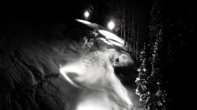 september 16 2009 montage an extreme free skier making a night time back country run through fresh powder/ minnesota united states - freestyleskidåkning bildbanksvideor och videomaterial från bakom kulisserna