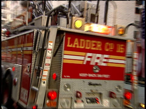 september 17, 2001 ladder truck leaving firehouse with siren on and lights flashing / new york city, new york, united states - 消防車点の映像素材/bロール
