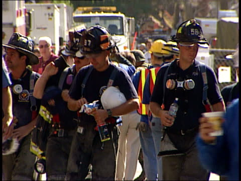 September 17 2001 MONTAGE Firefighters walking / New York City New York United States