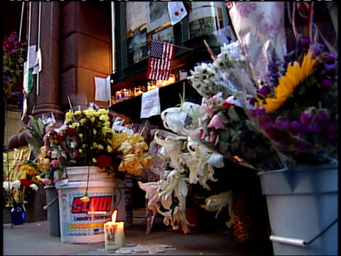 september 17, 2001 montage lit candles, wreaths, flags, and flower memorials sitting on the sidewalk / new york city, new york, united states - 2001 stock videos & royalty-free footage