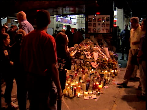 september 17, 2001 montage pedestrians gathering on sidewalk around a memorial of lit candles in front of a fire station / new york city, new york,... - 2001 stock videos & royalty-free footage