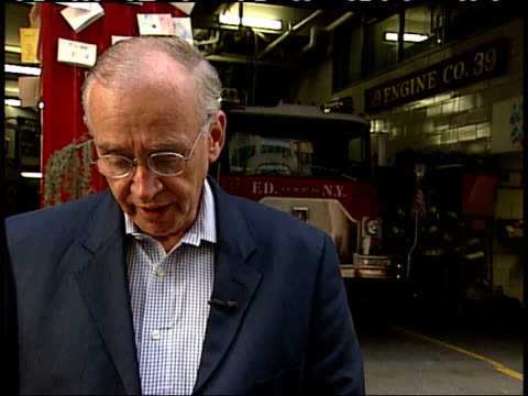 september 17 2001 cu nyfd official speaking outside firehouse about why so many firemen were lost in the world trade center on 9/11 / new york city... - anno 2001 video stock e b–roll