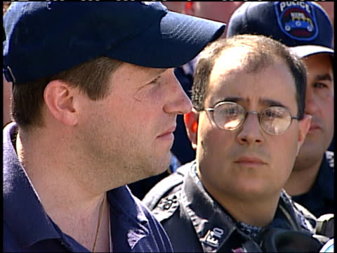 september 17, 2001 police department spokesman getting teary as he speaks to the press while surrounded by solemn fellow officers / new york city,... - spokesman stock videos & royalty-free footage