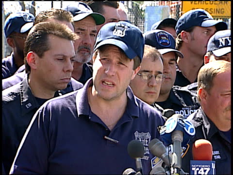 September 17 2001 MS Police department spokesmen surrounded by fellow officers speaks to press / New York City New York United States