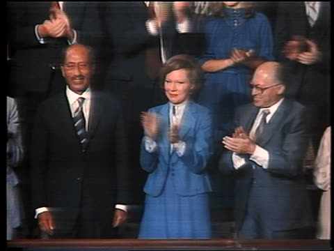 stockvideo's en b-roll-footage met september 18 1978 rosalynn carter stands between anwar elsadat menachem begin as they are recognized during a joint session of congress / washington... - 1978