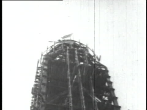 september 19, 1930 american flag atop incomplete tower during empire state building construction / new york city, new york, united states - 1930 stock videos & royalty-free footage