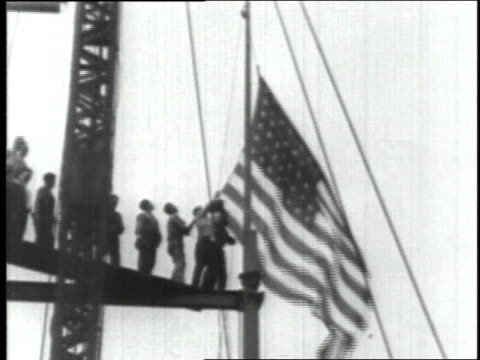september 19, 1930 workers raising american flag during empire state building construction / new york city, new york, united states - 1930 stock videos & royalty-free footage