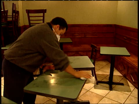 september 19 2001 montage maskwearing restaurant worker washing dust covered tables / new york city new york united states - 2001 stock-videos und b-roll-filmmaterial