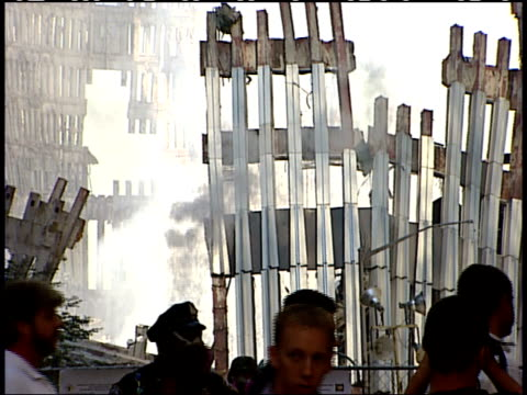 september 19 2001 zi pedestrians walking past smoldering remains of world trade center after the terrorist attack / new york city new york united... - 2001 bildbanksvideor och videomaterial från bakom kulisserna