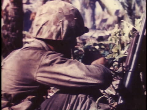 vidéos et rushes de september 1944 montage marines drinking water and taking cover / peleliu, palau - infanterie
