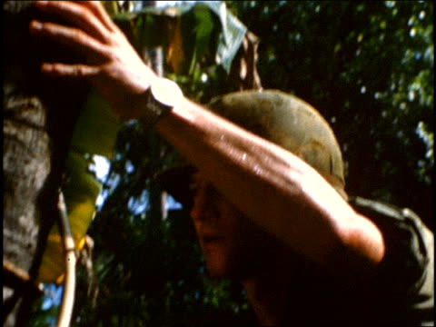 september 1967 ts a soldier intentionally sets off a booby trap in jungle / vietnam - ブービートラップ点の映像素材/bロール