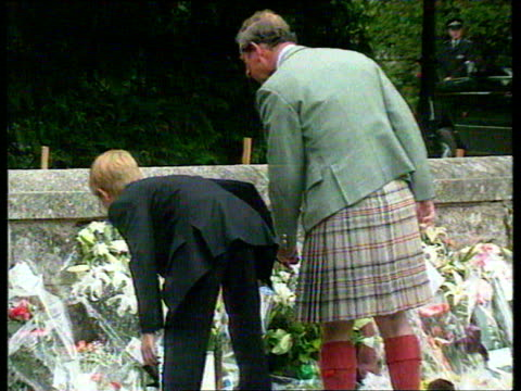 stockvideo's en b-roll-footage met september 1997 film montage prince philip, queen elizabeth, prince charles, prince william, prince harry, and peter phillips looking at flowers left... - 1997
