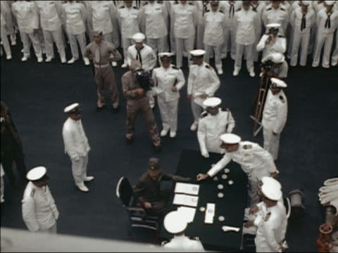 september 2 1945 high angle us and japanese naval officers signing surrender aboard uss portland / truk atoll - guerra del pacifico video stock e b–roll