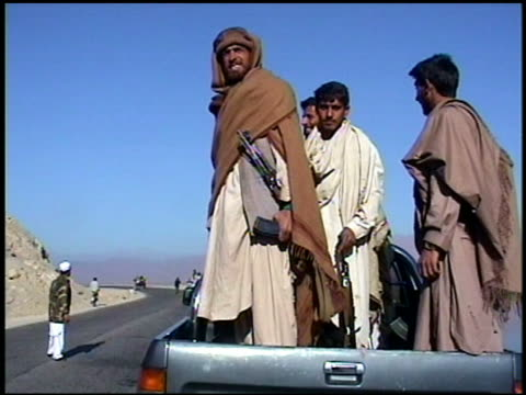 september 2002 group of soldiers standing in back of a pick-up with guns / afghanistan - 30 39 years stock videos & royalty-free footage