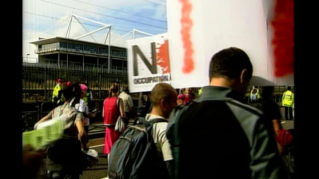 East London Docklands Excel Centre EXT Antiwar protestors march near Excel Centre