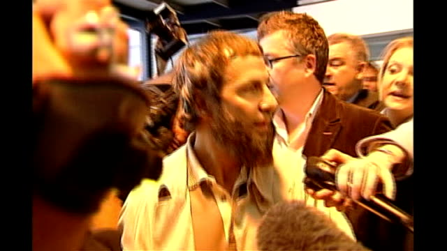 INT Yusuf Islam along through press pack after arriving back in Britain following his ejection from America