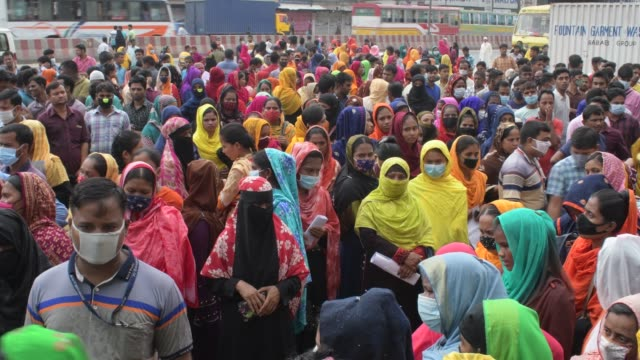 september 2020: job seekers garments workers are waiting in front of a garment factory at ashulia on the outskirts of the capital dhaka. many of... - employment issues stock videos & royalty-free footage