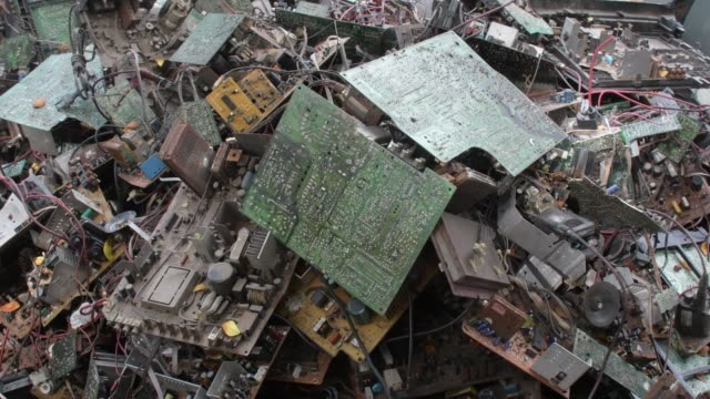 september 2020: old tv components are discarded inside at a tv recycling scrap yard in dhaka. - electrical equipment stock videos & royalty-free footage