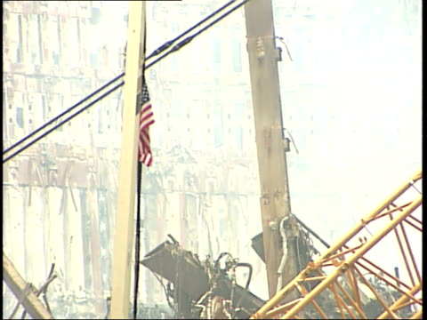 september 21, 2001 american flag attached to temporary light tower in the midst of smoldering rubble in manhattan following 9/11 terror attack / new... - rubble stock-videos und b-roll-filmmaterial
