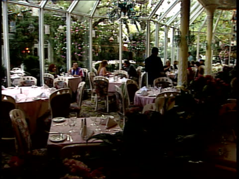 september 21, 2001 diners and waiters in fine atrium restaurant / new york city, new york, united states - dining stock videos & royalty-free footage