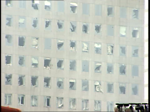 september 21, 2001 office building with blown out windows and smoldering rubble in manhattan following 9/11 terror attack / new york city, new york,... - rubble stock-videos und b-roll-filmmaterial