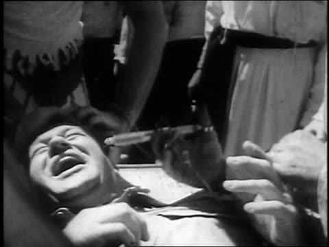 september 22 1947 b/w staged treating of patient by doctor truman laughing as someone tickles his feet / rio de janiero brazil - documentary footage stock videos & royalty-free footage