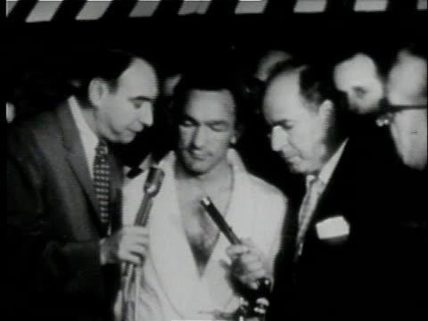 september 23, 1957 howard cosell interviews boxer carmen basilio just before match against sugar ray robinson at yankee stadium/ bronx, new york - 1957 stock videos & royalty-free footage