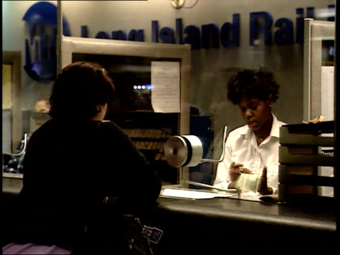 september 25 2001 zo commuter at ticket counter at penn station / new york city new york united states - long island railroad stock videos and b-roll footage
