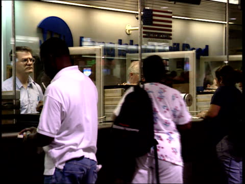 september 25 2001 pan commuters at ticket counter at penn station / new york city new york united states - new york city penn station stock videos and b-roll footage